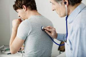 man coughing, doctor checking heartbeat